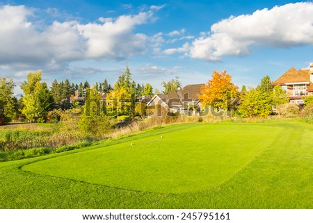 Beautiful sunny green golf course with pond in Vancouver, Canada - stock photo