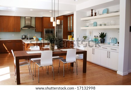 Beautiful sunny kitchen and dining room - stock photo