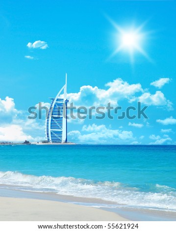 Beautiful sunny seascape with a Hotel on the beach - stock photo
