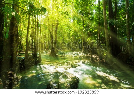 Beautiful sunray and waterfall in rainforest, Emerald Pool - Krabi - Thailand - stock photo