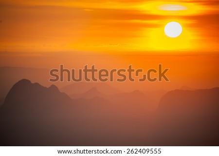 Beautiful sunrise above the mountains - stock photo