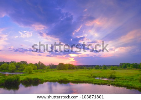 Beautiful sunrise and dramatic clouds on the sky. - stock photo