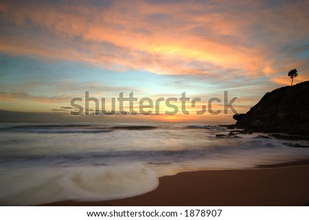 Beautiful Sunrise at the Beach Background. Slow Shutter Speed. - stock photo
