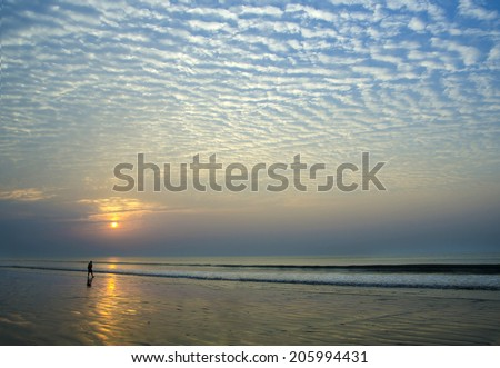 Beautiful Sunrise at the Indian Beach called Digha - stock photo