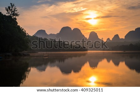 Beautiful sunrise at the nongtalay lake in krabi,Thailand - stock photo