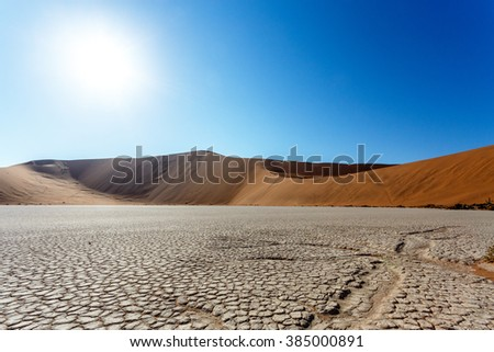 beautiful sunrise dune in hidden Dead Vlei in Namib desert with blue sky, this is best place of Namibia - stock photo