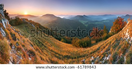 Beautiful sunrise in mountain valley with sun - stock photo