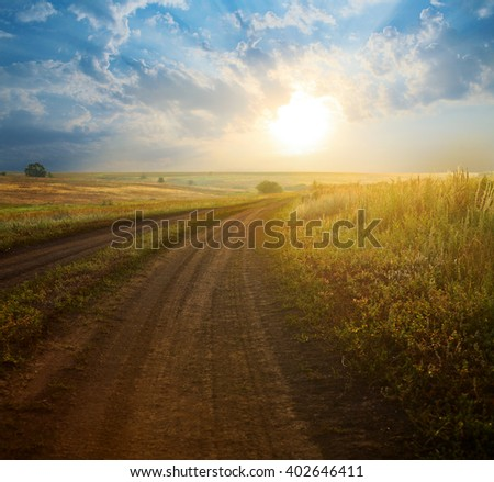 Beautiful sunrise in the field in the summer