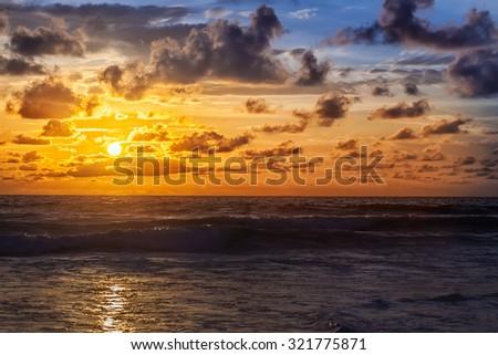 Beautiful sunrise in the Indian Ocean - stock photo