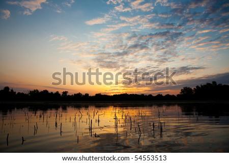 Beautiful sunrise landscape from the Danube Delta Biosphere Reserve in Romania - stock photo