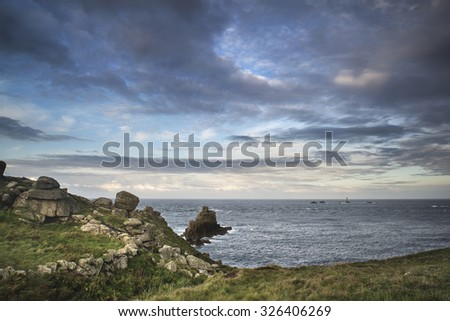 Beautiful sunrise landscape image of Land's End in Cornwall England - stock photo