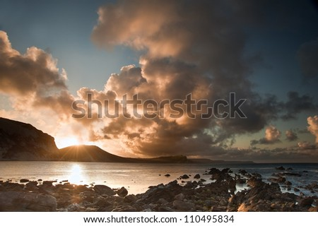 Beautiful sunrise landscape over Mupe Bay on Jurassic Coast in Dorset, England