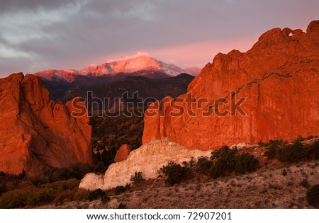 Beautiful sunrise light on Pikes Peak and Garden of the Gods park. - stock photo
