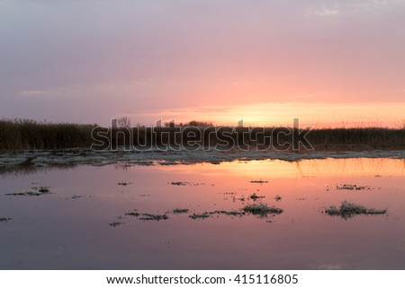 beautiful sunrise of the sun on the lake - stock photo