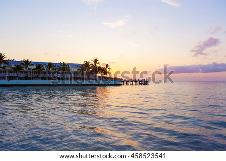 Beautiful sunrise on Key West, Florida, USA. With palms and resorts on background - stock photo