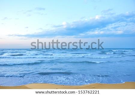 beautiful sunrise on the ocean beach - stock photo