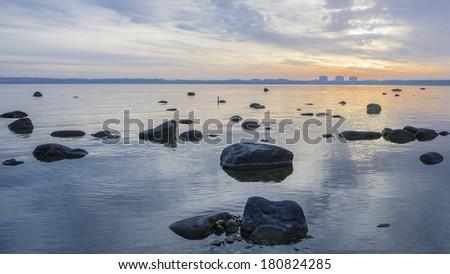 Beautiful sunrise on the sea. Views of Tallinn. - stock photo