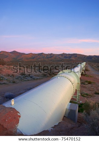 Beautiful sunrise over a pipeline in the Mojave Desert, California. - stock photo