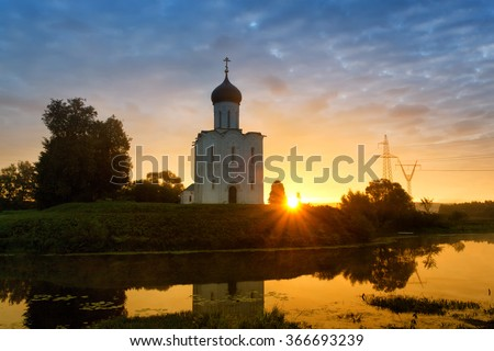 Beautiful sunrise over Church of the Intercession of the Holy Virgin on Nerl River, Bogolyubovo, Russia