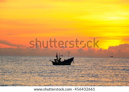 Beautiful sunrise over fishing boats in the morning in Songkhla Thailand.