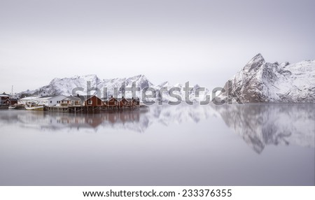 Beautiful sunrise over Hamnoy village, Lofoten islands, Norway in winter - stock photo