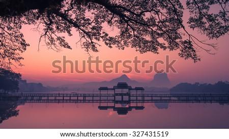 Beautiful sunrise over Kan Thar Yar lake in Hpa An Myanmar (Burma). Landmarks and tourist travel destinations in Asia - stock photo