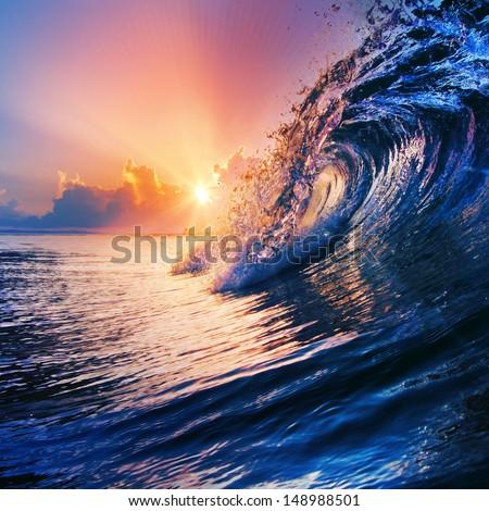beautiful sunrise over ocean seascape with nice clouds on horizon - stock photo