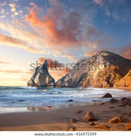 Beautiful sunrise over Rocky ocean beach, Wonderful world Landscape. Portugal, Europe - stock photo