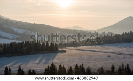 Beautiful sunrise over the countryside in winter