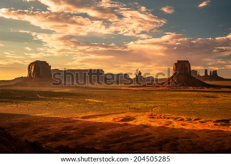 Beautiful sunrise over the iconic Monument Valley, Arizona, USA - stock photo
