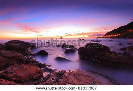 Beautiful sunrise over the Rocky Coast - stock photo