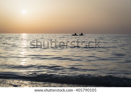 Beautiful sunrise over the sea, sun road, fishermen