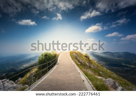 Beautiful sunrise over top of the mountain Lovcen at Montenegro - stock photo