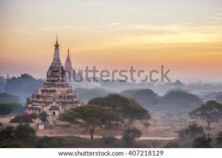 Beautiful sunrise scene at ancient pagoda in Bagan , Myanmar - stock photo
