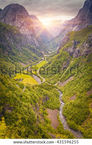 Beautiful sunrise scene over mountain and Green Valley, Norway Mountain Landscape, Odda, Norway - stock photo