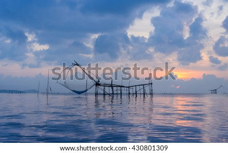Beautiful sunrise seascape with Chinese fishing nets or shore operated lift nets in Phatthalung, Thailand - stock photo