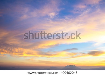 Beautiful sunrise sky and clouds over mountain.