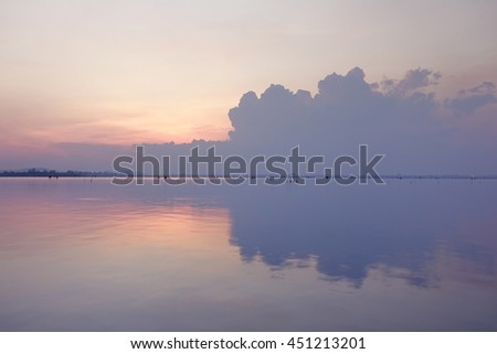 beautiful sunrise sky with reflection in water,select focus with shallow depth of field:ideal use for background.