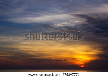 Beautiful sunrise sky with sea. - stock photo