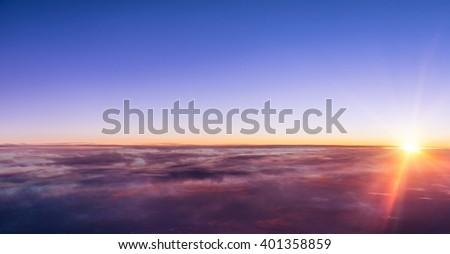 Beautiful sunset above clouds - stock photo