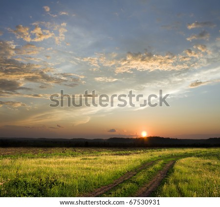 Beautiful sunset above rural lane. Square composition - stock photo