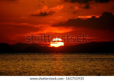 Beautiful sunset above the lake - stock photo