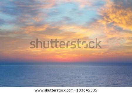 Beautiful sunset above the sea - stock photo