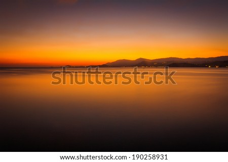 Beautiful sunset above the sea on the island in gold colours - stock photo