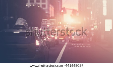 Beautiful sunset along a New York street blurred background with filtered light leak - stock photo