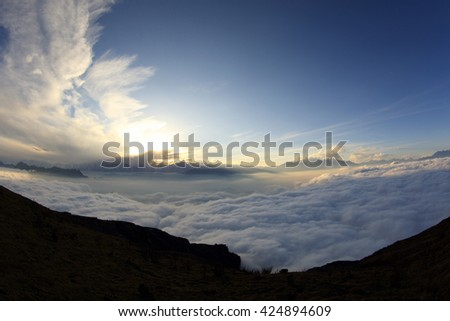 beautiful sunset among foggy mountain summits landscape - stock photo
