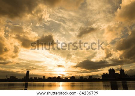 Beautiful sunset and the clouds with river - stock photo