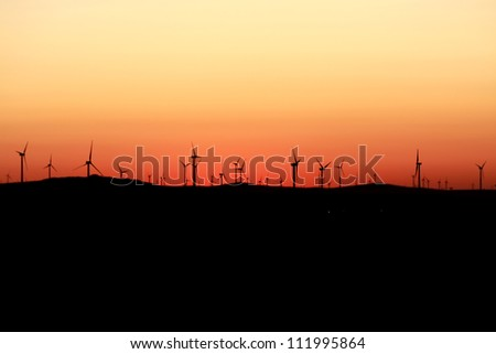 Beautiful sunset and wind turbines