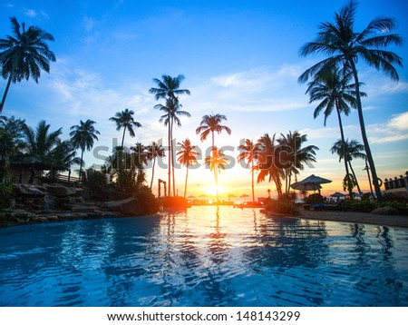 Beautiful sunset at a beach resort in tropics - stock photo