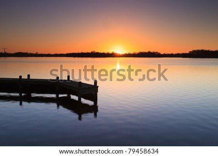 Beautiful sunset at a lake - stock photo